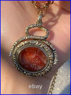 Large Victorian Heavily Chased 14K Gold and Carnelian Intaglio Spinner Pendant